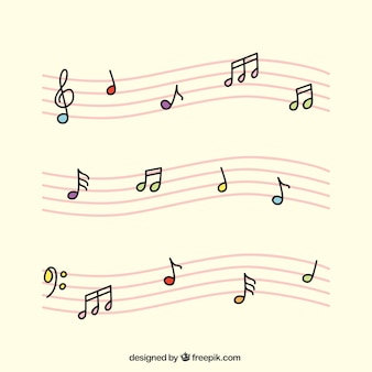 Pentagramas rosas con notas musicales