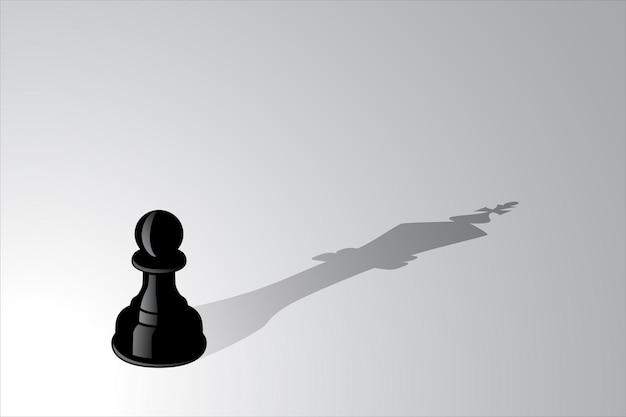 Peón de ajedrez proyectando una sombra de pieza de rey