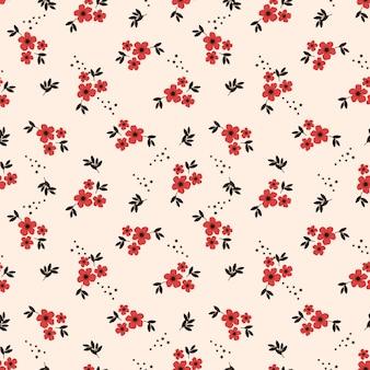 Pequeña flor roja de patrones sin fisuras