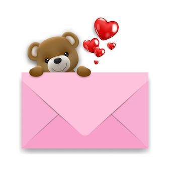 La pequeña y linda muñeca de oso sonriente realista sube detrás de una cota blanca con corazones.