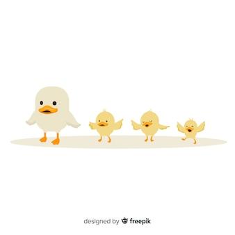 Pequeña madre pato y patitos
