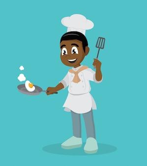 Pequeño chef africano con sartén.