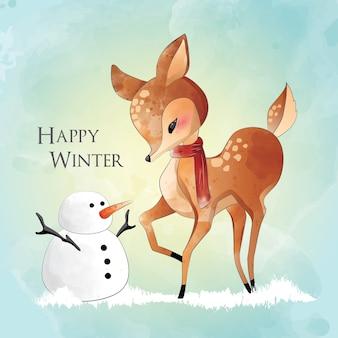 Pequeño ciervo y un muñeco de nieve