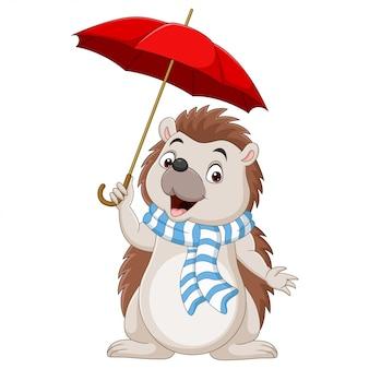 Pequeño erizo de dibujos animados en una bufanda con paraguas