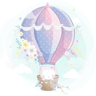 Pequeño gatito lindo en el globo de aire