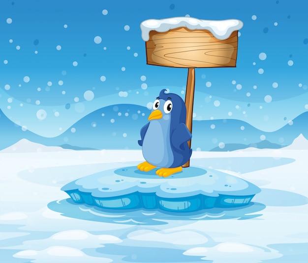 Un pequeño pingüino debajo del letrero de madera vacío