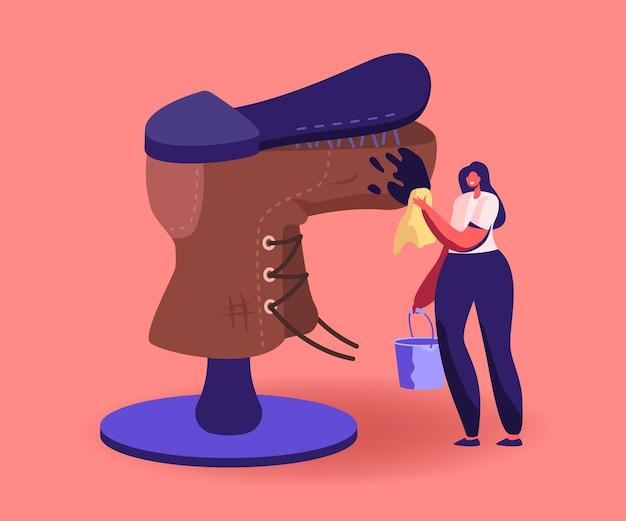Pequeño zapatero reparación de personajes una enorme bota desgastada quita la suciedad, maestro en el taller arreglando un zapato roto