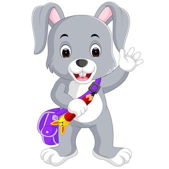 Pequeños dibujos animados de conejos van a la escuela