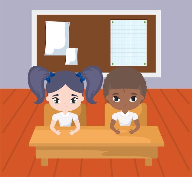 Pequeños estudiantes en la escena del aula