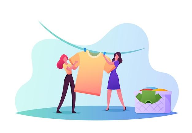 Pequeños personajes femeninos secando ropa mojada