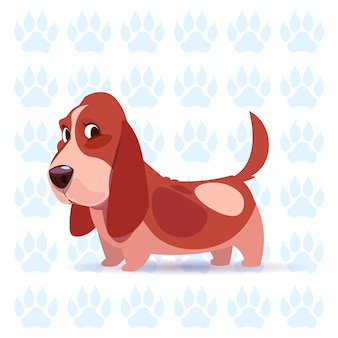 Perro basset hound dibujos animados feliz sentado sobre huellas de fondo linda mascota