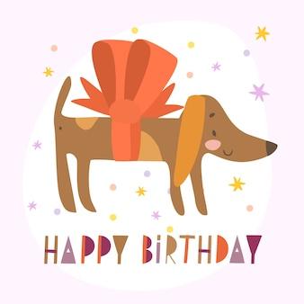 Perro salchicha con saludo de cumpleaños de arco
