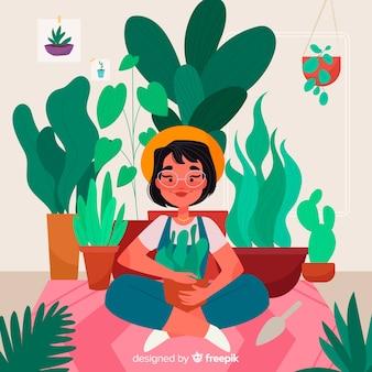 Persona cuidando de las plantas