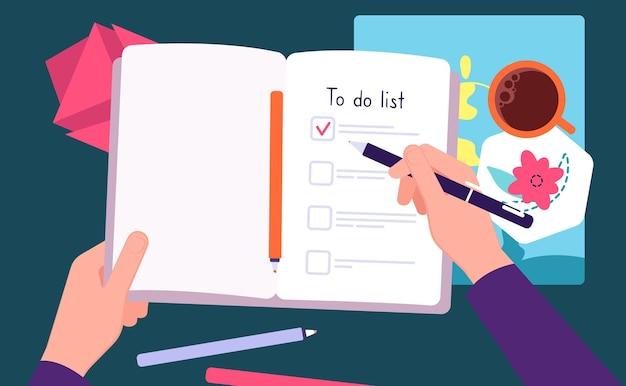 Persona llene el cuaderno. lista de tareas pendientes, tareas del día con café de la mañana. diario de viñetas o diario. espacio de trabajo, manos humanas escriben vista superior