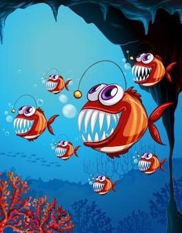 Personaje de dibujos animados de peces rape en la escena submarina con corales
