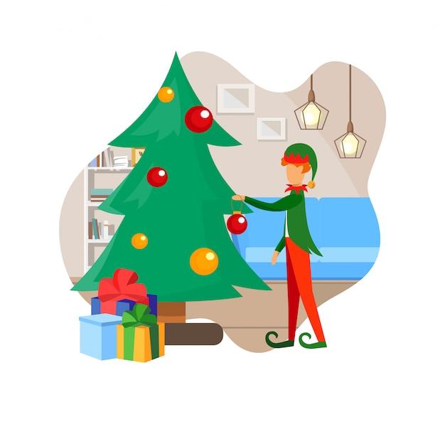 Personaje de duende en traje decorando arbol de navidad