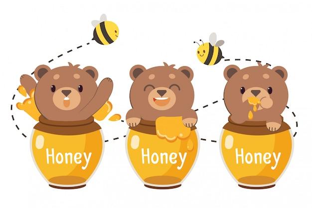 El personaje del lindo oso de peluche marrón en el tarro de miel.