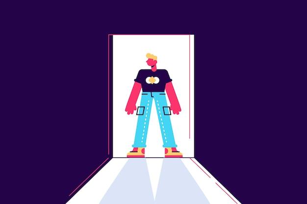 Personaje masculino joven de pie en una puerta de contraste de luz y sombra