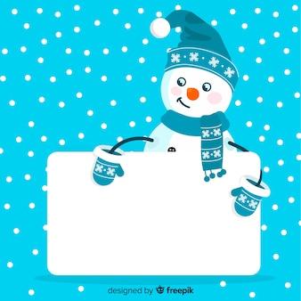 Personaje de navidad con una tarjeta blanca dibujado a mano