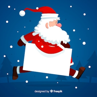 Personaje de navidad con una tarjeta blanca