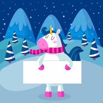 Personaje de navidad unicornio sosteniendo pancarta en blanco