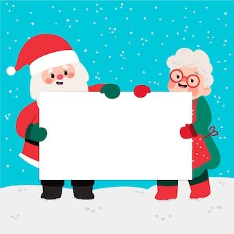 Personajes de navidad sosteniendo pancarta en blanco