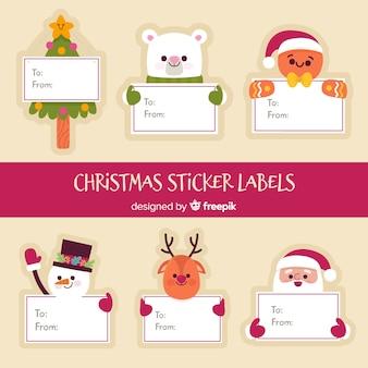 Personajes de navidad con una tarjeta