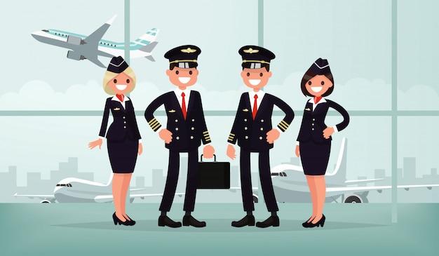 Personal de aeronaves. la tripulación del avión civil en el edificio del aeropuerto. pilotos y azafatas.