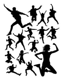 Personas activas saltando silueta