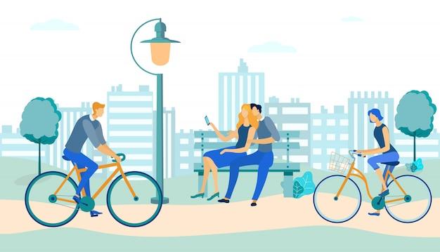 Personas andan en bicicleta, pareja en el banco en el parque.