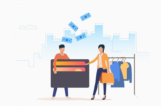 Personas comprando ropa con tarjeta de crédito.