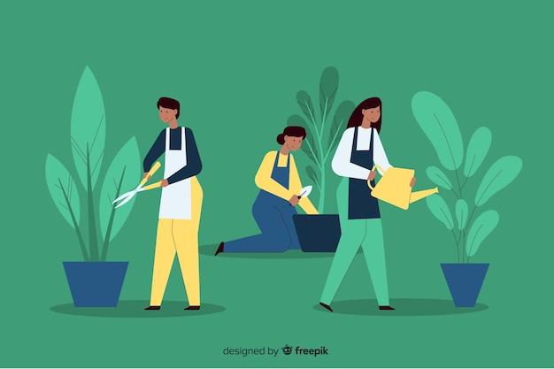 Personas cuidando plantas