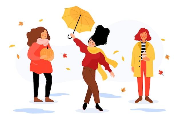 Personas dibujadas a mano en ropa de otoño al aire libre.