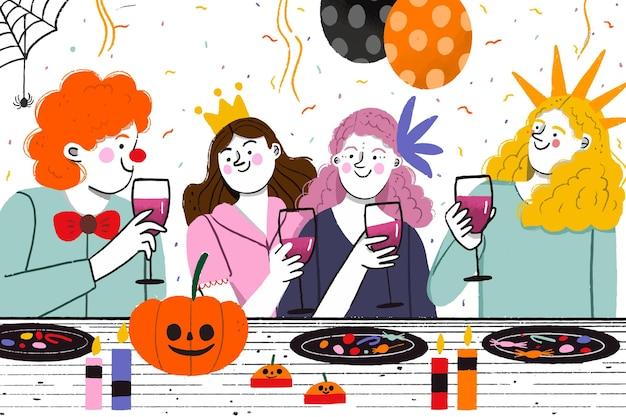 Personas disfrazadas con una cena de halloween.