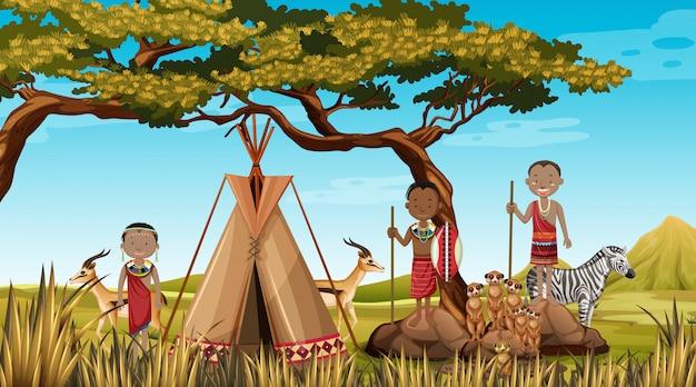 Personas étnicas de tribus africanas en ropa tradicional en el fondo de la naturaleza