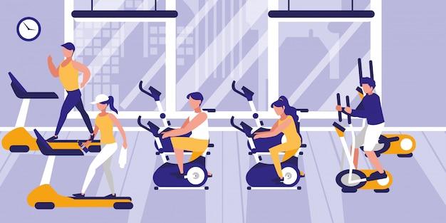 Personas en el gimnasio practicando deportes