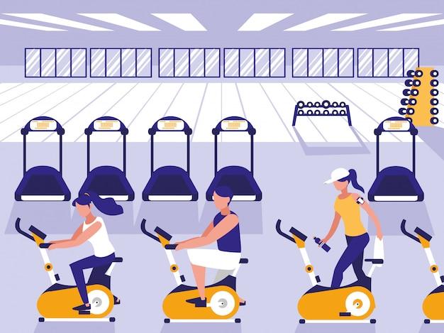 Personas montando bicicleta spinning en gimnasio deportivo