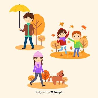 Personas paseando en un parque en otoño