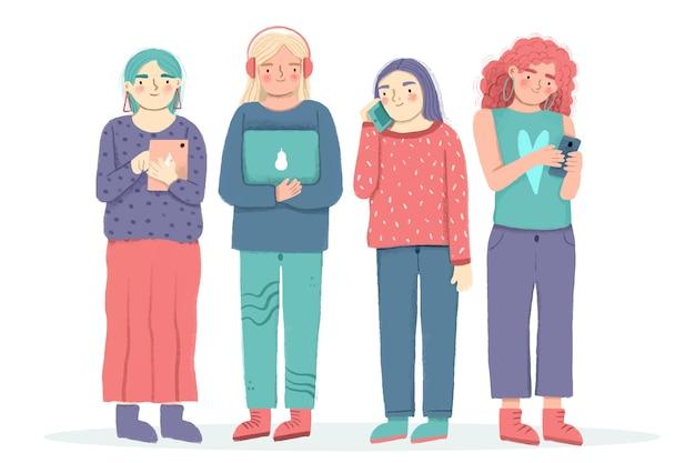 Personas de pie con dispositivos tecnológicos