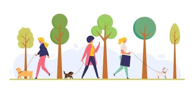 Personas planas con mascotas en el parque.