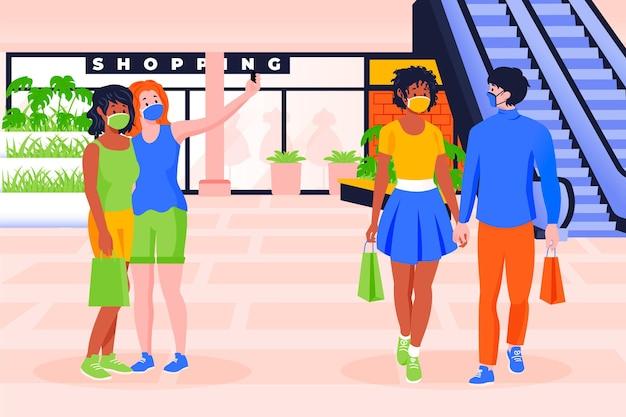 Personas que regresan a centros comerciales en nuevas escenas normales