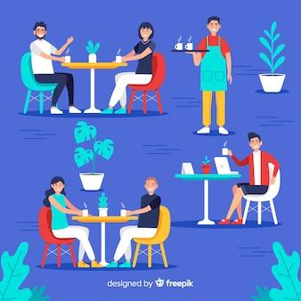 Personas sentadas en la cafetería