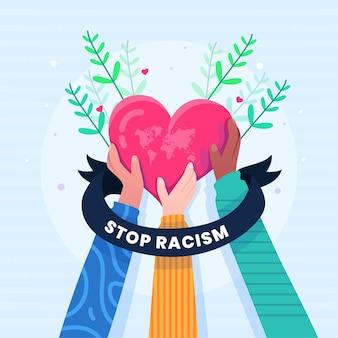 Personas sosteniendo un corazón con mensaje de detener el racismo