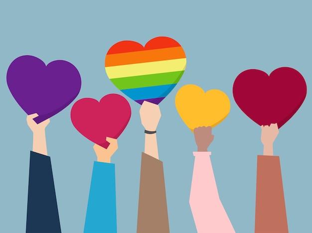 Personas sosteniendo ilustración de corazones