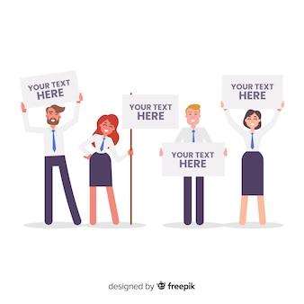 Personas sujetando cartel