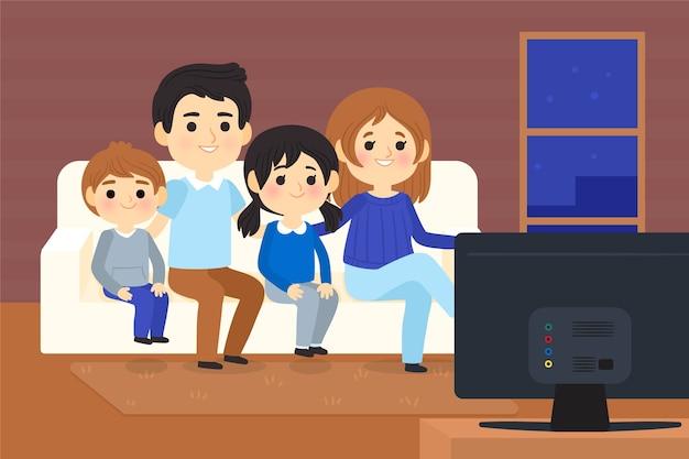 Personas viendo una película en casa por televisión