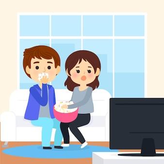 Personas viendo una película en casa
