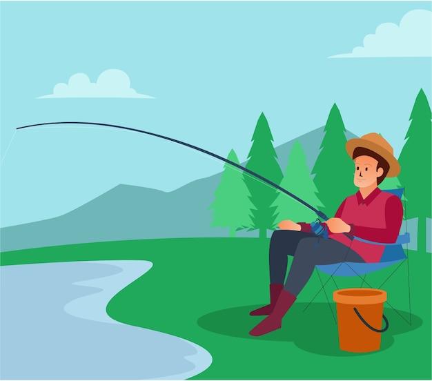 Un pescador está en un lago en invierno para pescar.