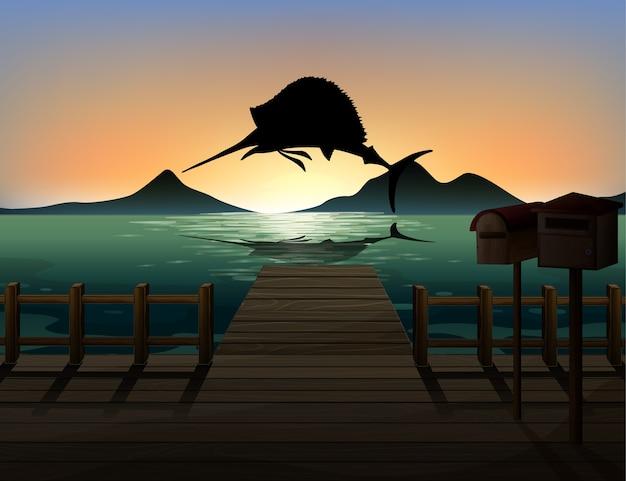 Pez marlin en silueta de escena de naturaleza