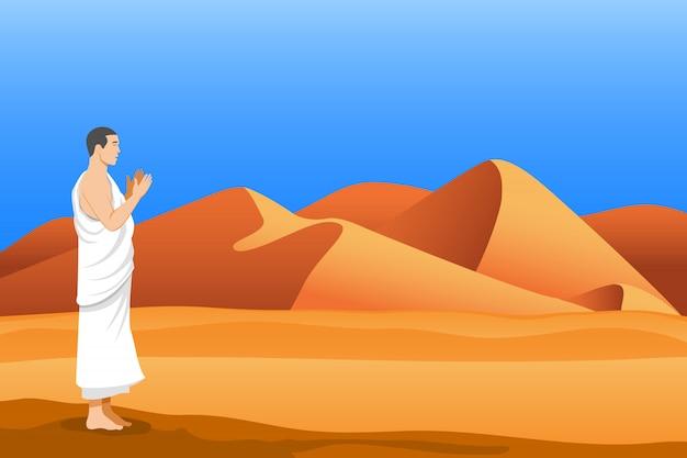 De pie y rezando del peregrino hajj en el desierto